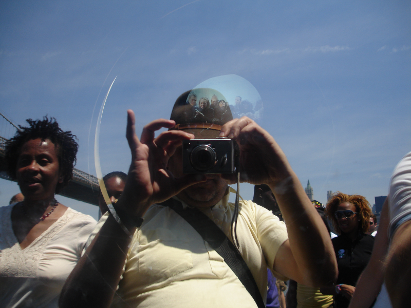Self Portrait of Ruben Taking a Picture through the Glass of the Optical exhibit at Fulton Ferry